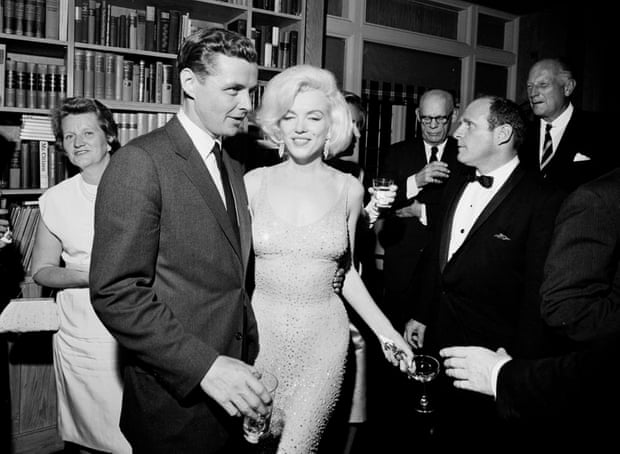 Marilyn Monroe still wearing the dress, with Steve Smith, Kennedy's brother-in-law, at a reception at Madison Square Garden. Photograph: Cecil Stoughton/AP